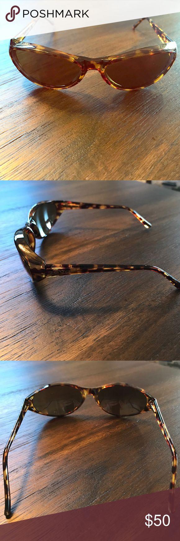 Revo irredescent lenses Sports Sunglasses. Revo irredescent lenses Sports Sunglasses. Used but in excellent condition. UVA/UVB 100. Tortoise Plastic Frames. Comes with original case. Revo Accessories Sunglasses