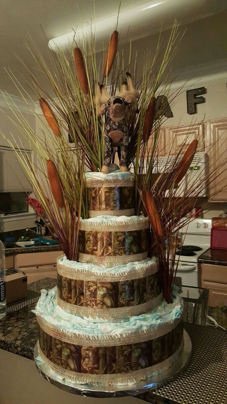 Hunting themed diaper cake. This picture is missing the bright orange bow that I tied around the neck of the stuffed animal. (moose cake baby)