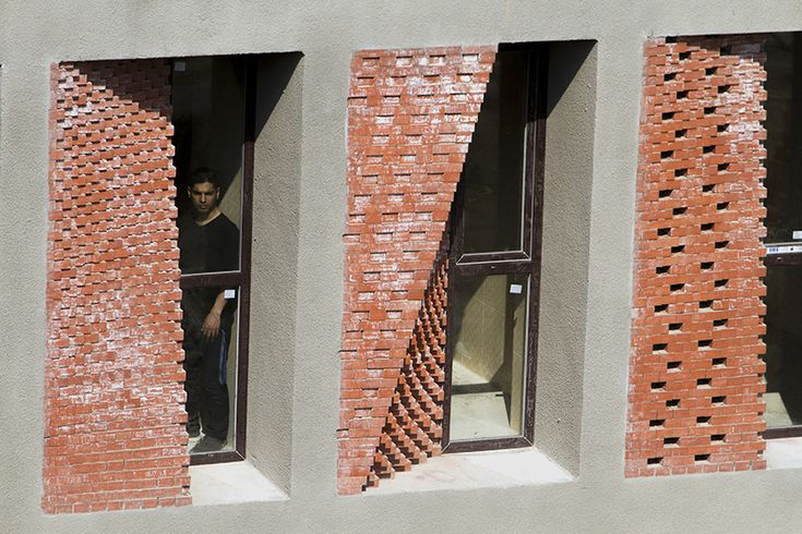 caat studio uses bricks to diversify low-cost apartment complex in iran
