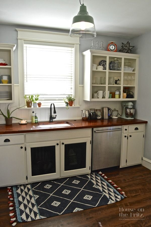 Love this! Gretchen spent less than $1,500 on her kitchen remodel, which includes new wood countertops | hookedonhouses.net
