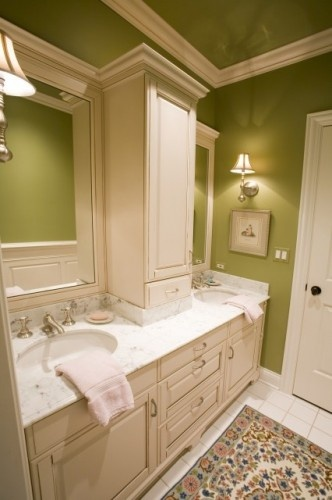 I like this for a basement bathroom.  Avocado green bathroom with crown moldings and painted ceiling.  Different light fixtures for sure though.