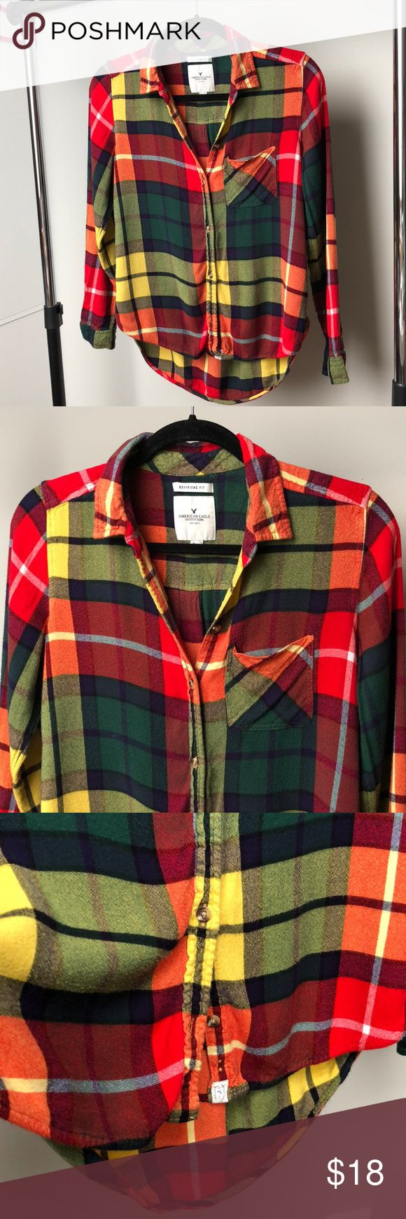 AE Boyfriend Flannel In great condition AEO Boyfriend Flannel from their Holiday Collection purchased at an American Eagle store. Super soft and comfy. Colors are vibrant, all buttons are intact. American Eagle Outfitters Tops Button Down Shirts