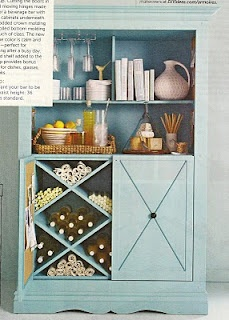 DIY: Entertainment center turned bar. Simple! Take off the doors, pick a