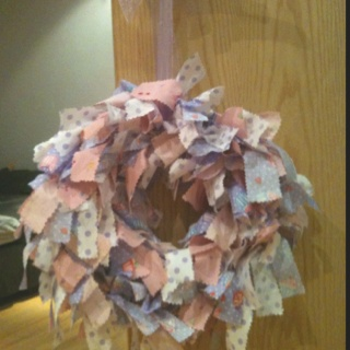 Pretty baby wreath I made from a florist wreath and fabric strips