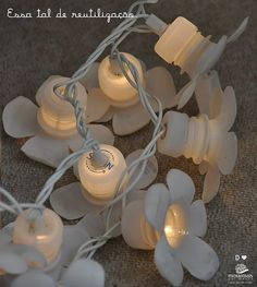 Plastic bottle caps and plastic bottle tops used to make fairy lights