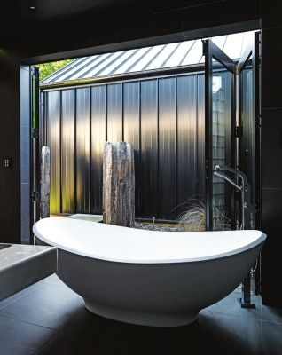 The black master bedroom en suite opens onto what will one day be a private hot tub area.