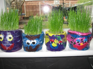 """Love the clay-pot faces made for the grass 'hair' ("""",)"""