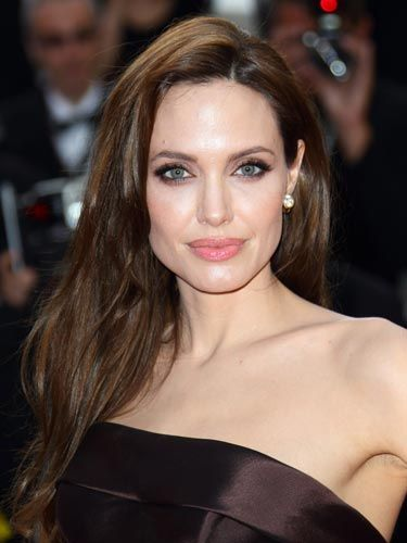Sultry, Smoky Eyes  Angelina Jolie's sexy look is all about smoky eyes in rich shades of brown. Use a palette of different hues, like Rimmel Glam Eyes Quad, focusing the darkest color around your lashline and blending outward.    Read more: Celebrity Hair and Makeup Pictures from Cannes 2011 - Pictures from Cannes Film Festival - Cosmopolitan