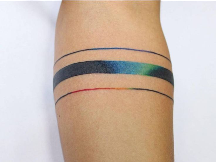 Spectrum armband tattoo on the forearm. Artista Tatuador: Ann Lilya