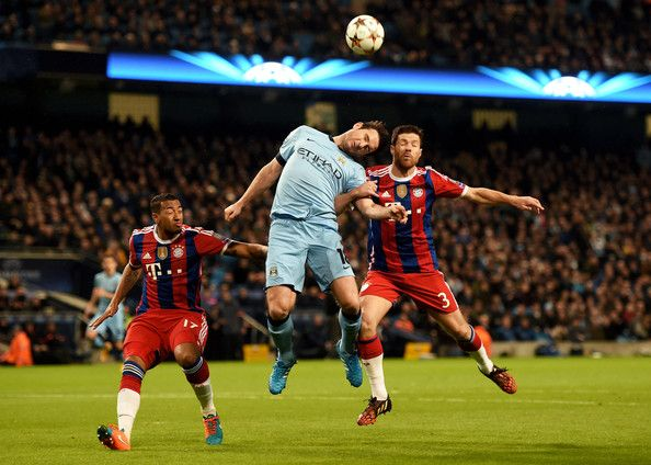 Frank Lampard of Manchester City heads the ball under pressure from Jerome Boateng (L) and Xabi Alonso (R) of Bayern Muenchen and during the UEFA Champions League Group E match between Manchester City and FC Bayern Muenchen at the Ethad Stadium on November 25, 2014 in Manchester, United Kingdom.