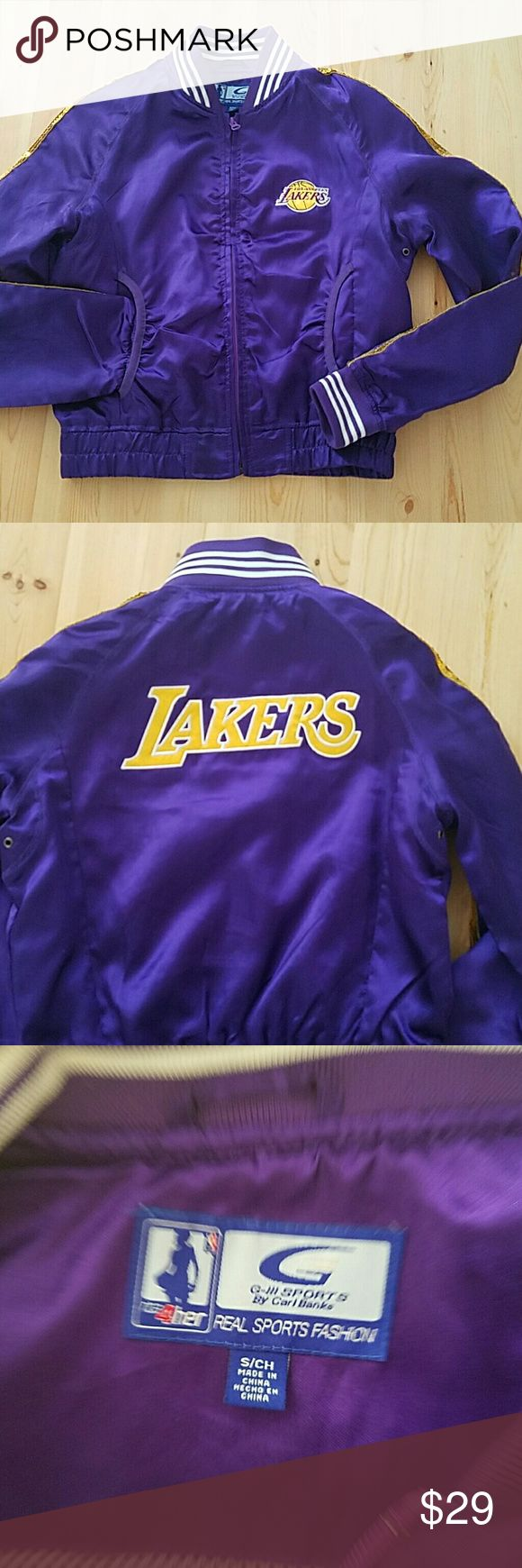 Satin Laker Girl Lakers Jacket Show your love for the Lakers with this satin bomber jacket. Has two pockets in front, gold sequins down the side of the sleeves, and yellow Lakers logo on the front and back. Jackets & Coats Utility Jackets