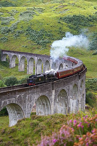 The classic train on the Glenfinnan Viaduct in Scotland. This train is also used in the Harry Potter films. Shot with Canon 18-55 mm kit lens with Canon 350D.