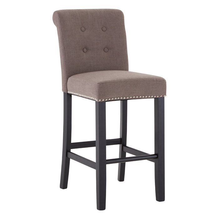 Upholstered with natural-coloured linen, this comfortable bar chair has a supportive backrest. Silver stud detail around is apron creates a metallic contrast to its light-coloured linen upholstery. Its slim black legs are made from renewable hevea wood, complete with a footrest that enhances its usability.