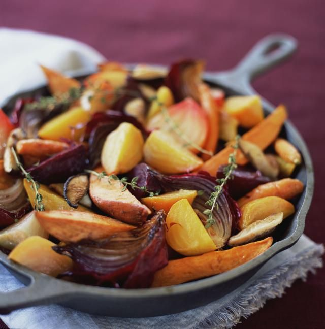 Oven roasting caramelizes zucchini, squash, bell peppers, asparagus, and onion in this roasted vegetables recipe from the South Beach Diet.
