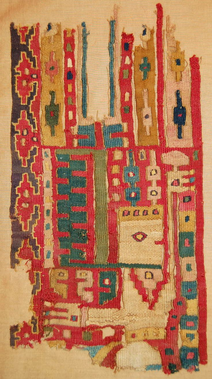 Textile fragment; camelid wefts(?); slit tapestry; features elaborately garbed figure with headdress and bearing staff in 1 hand; profile head, frontal body; surrounded by geometric patterning; red, tan, cream, blue, green, pink.