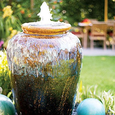 Pot fountain Have one of these.... Love it.... Hubby is working on finishing the area with green plants around this water pot. Love the water sound and the wind chimes.... what more could one ask for???? Ammmmmmmmmmmm give me a second.... lol