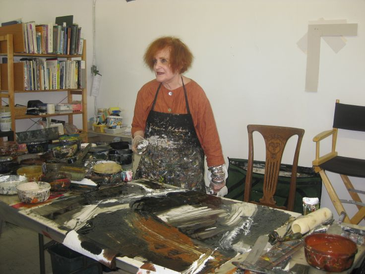 Lila Lewis Irving demonstrating technique to  her art students.