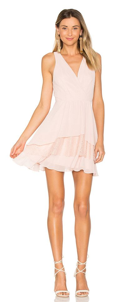 Surplice Ruffle Dress by BCBGeneration. Self & Lining: 100% polyContrast: 100% nylon. Fully lined. Pleated surplice neckline. Tiered hem with lace detail. Ba...