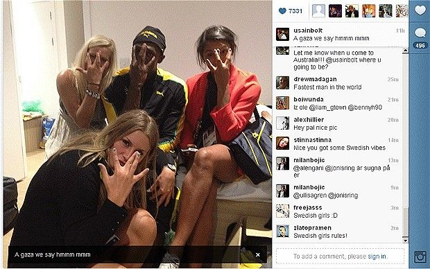Usain Bolt celebrates 100m gold with Swedish women's handball team