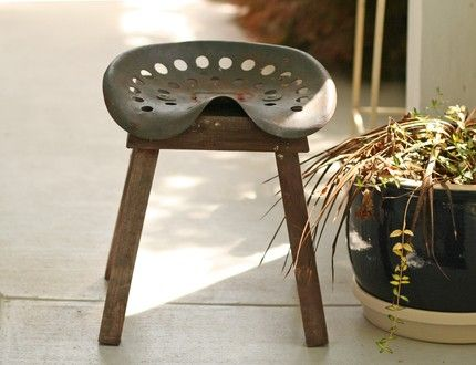 Vintage Tractor Seat Stool: Rusty and old tractor seat made into garden stool