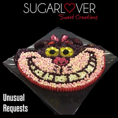Cheshire Cat Sweet cake.  Made entirely of sweets - who can resist that grin!