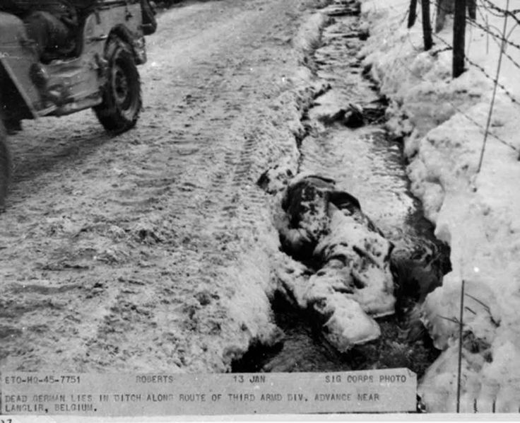 """JAN 13 1945 Battle of the Bulge – Germans attempt to escape - See more at: http://ww2today.com """"Dead German lies in ditch along route of Third Army Division advance near Langlir, Belgium."""" 13 January 1945."""