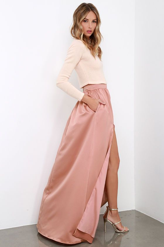Poets and laureates alike will muse upon how lovely you look as you wander through the gardens in the 'Twas a Dream Blush Maxi Skirt! Satiny woven fabric with a luxurious sheen falls from a high, fitted waist into a billowing maxi skirt with a sultry thigh high slit. Hidden zipper/hook closure at back.