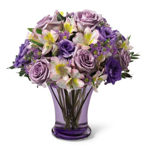 A purple flower bouquet to please! The Lavender Dreams Bouquet is a filled with bright purple flowers to lighten up someone's day. Shop SendFlowers.com for flowers delivered today.