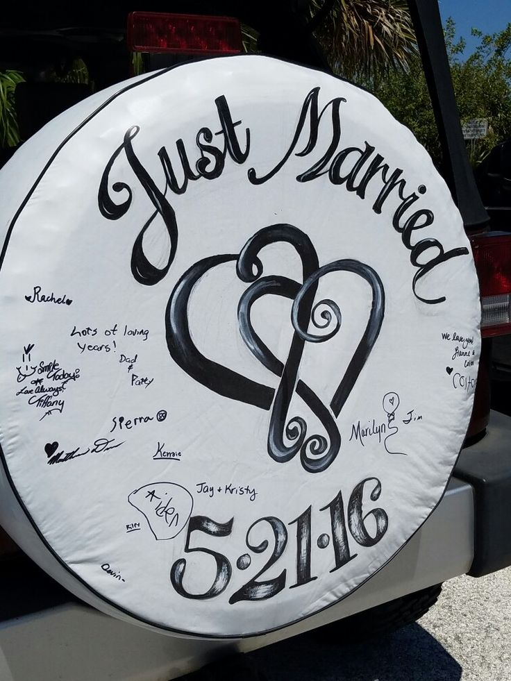 Saw this on a recent trip to FL...it's a tire cover for the spare on a Jeep Wrangler. Not sure you can tell, but the wedding guests signed the cover. Such a cute wedding idea!