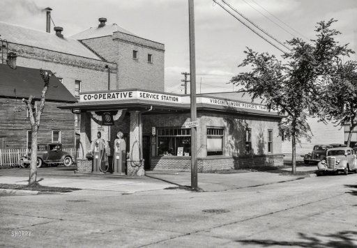 """""""Virginia, Minnesota -- cooperative service station of the Virginia Work People's Trading Company."""" August 1937.    One manifestation of the Iron Range consumer cooperative movement started by Finnish immigrants. Photo by Russell Lee for the Resettlement Administration."""