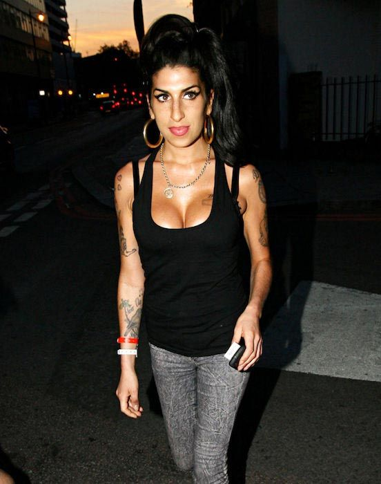 Singer Amy Winehouse after a boob job. She increase her breast size from 32B to 32D...