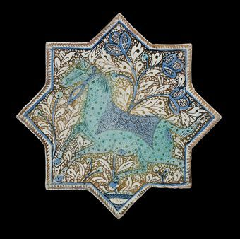 A Kashan cobalt-blue, turquoise and lustre painted pottery star tile.   Ilkhanid Iran, Late 13th century.
