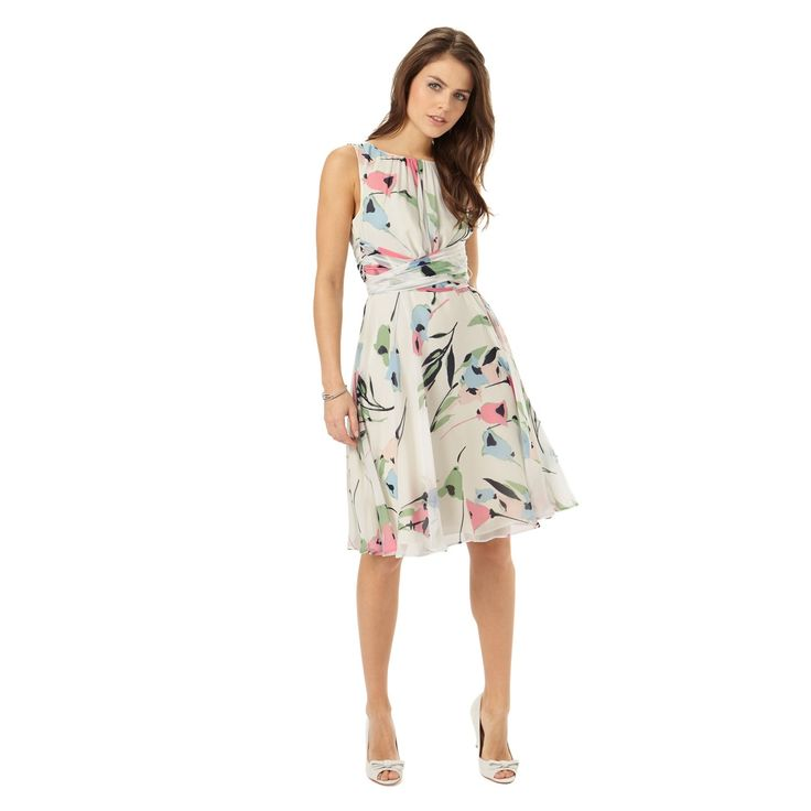 A beautiful, lightweight summer occasion dress in a contemporary floral design. This dress features a wrap detail at the waist to accentuate your figure, ruching at the neck and a V back. Complete with a full lining and a concealed back zip.