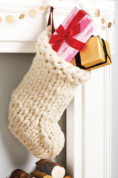 Chunky Knit: This Scandinavian-inspired chunky knit sweater stocking is so soft and cozy, you'll wish you could curl up in it on Christmas morning. Click through for more unique Christmas stockings!