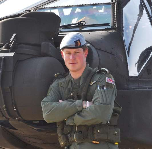 Prince Harry: Eye Candy  -  September 11, 2015.  Prince Harry made our hearts soar when he posed in front of a helicopter in this shot.