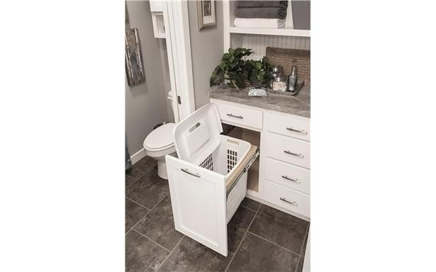 Pull-out hamper in the master bathroom - this makes total sense! Brilliant!
