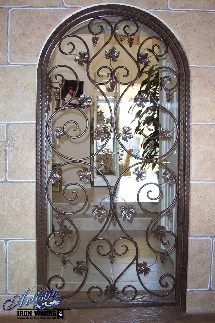 9 best wrought iron wine cellar doors images on pinterest for Wrought iron entry doors