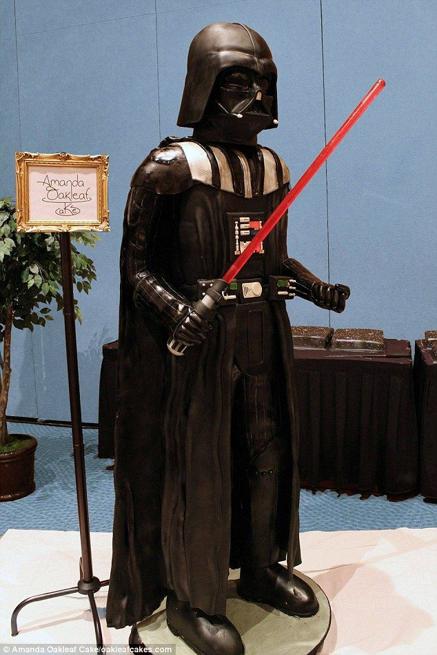 "Narrowly beating out the Food! Board. 6'7"" 500 pound Vader cake with watermelon flavored lightsaber."