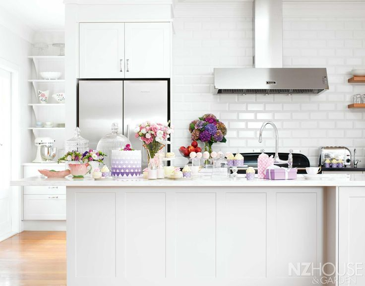 In Giselle and Matthew Reid's Hawke's Bay home, the kitchen is the social hub; in this photograph it's been styled by NZ House & Garden's art director Richard Brunton for the Mother's Day cover shoot and photographed by Belinda Merrie; the bevelled subway tiles are from Heritage Tiles and the Perrin & Rowe Ionian kitchen tap is from In Residence in Auckland.