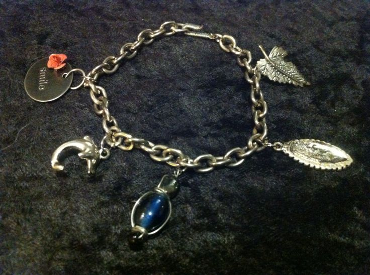 Junk drawer charm bracelet with wire wrapped clasp.