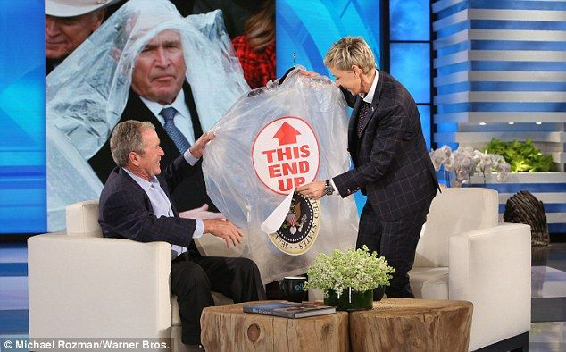 Ellen gave the 43rd commander in chief a plastic poncho with  'THIS END UP' written in big letters so that he wouldn't struggle to put it on like he did at President Trump's inauguration