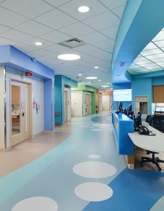 Circular recessed fluorescent overhead lights mimic the bubble design on the floor of this patient floor corridor at the Vidant Medical Center, James and Connie Maynard Children's Hospital, Greenville, N.C. Designed by @HDR Architecture  Inc. Photo: 2013 Don Schwalm/HDR Inc.