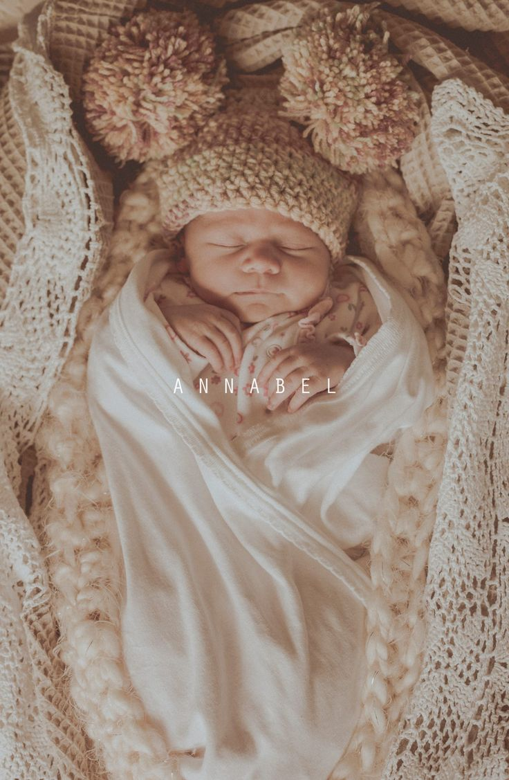 Our pompom pigtails hat and soft yellow cocoon used as props in this gorgeous newborn photo session