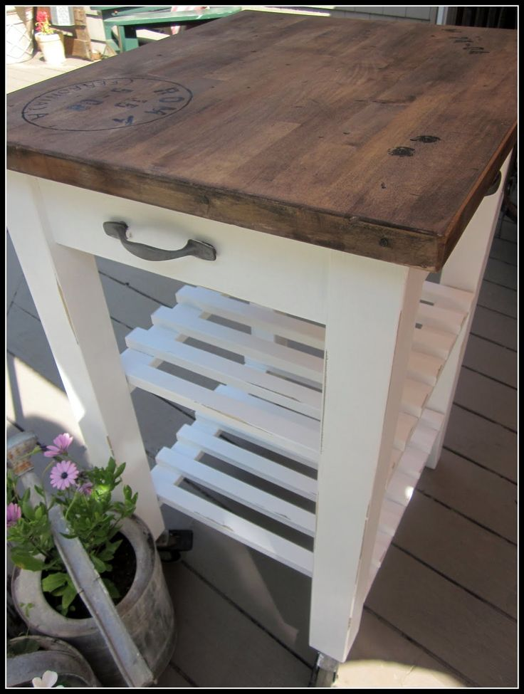 IKEA hack kitchen island cart. Love the wood top. After she sanded it, she whacked it with a hammer and put a few nails in the board for added character. Then stained (brown and black paint mixed with stain). And that postage cancellation stamp! She painted around a bowl for the circle (black paint) and stamped the letters on using an ink pad. Then sealed the top.  Voila!