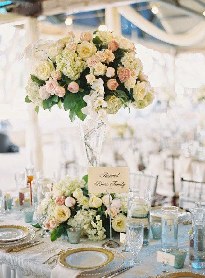 12 Stunning Wedding Centerpieces are an obsession around here. So much so, that we dedicate a monthly series to featuring the utmost spectacular centerpieces around the wedding cyber world; hand-picked by us, of course! And, if you missed out on last month's, just click here to be taken to a fabulous world of centerpiece works read more...