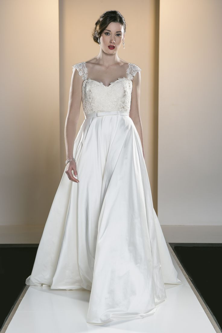 OCA 558T 'Olivia' An elegant full silk gown featuring an appliquéd Guipure lace bodice and a contrast tone silk skirt with matching Guipure lace cap sleeves.