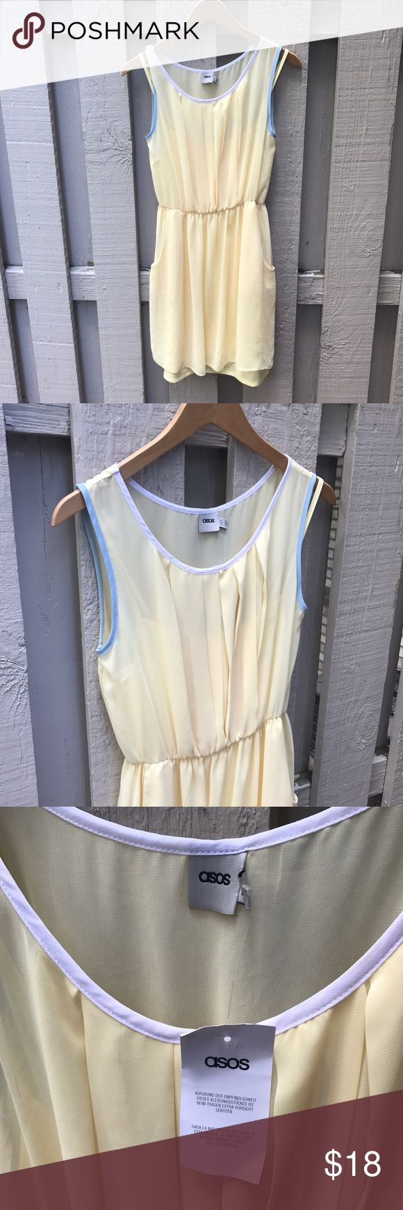 ASOS Summer Dress Beautiful light and airy ASOS butter yellow sheer dress with pleated bust and pockets. Baby blue and white trim on neck and sleeves. Elastic dropped empire waist. Comes with under slip with adjustable straps. Brand new, never worn with tags. 100% polyester. US size 6, UK size 10. Length 34 inches. ASOS Dresses