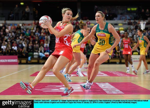 Natalie Haythornthwaite of England is challenged by Clare McMeniman of Australia…