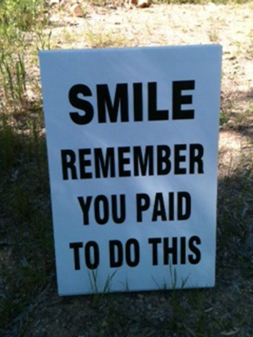 25 Funniest Running Signs At A Race: #12. SMILE. Remember you paid to do this.