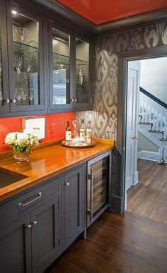 Image result for kitchen with orange walls grey tiles